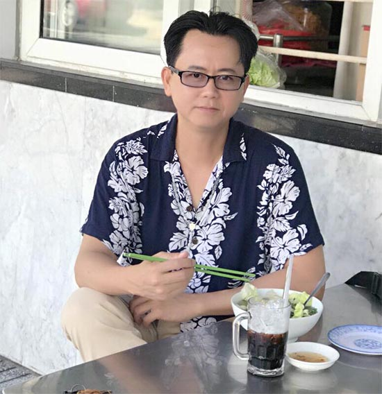 Viet Kieu sitting at coffee shop in Vietnam